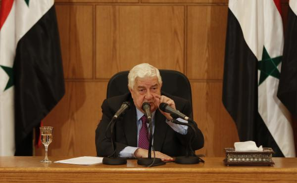 Syrian Foreign Minister Walid al-Moallem holds a news conference in the capital, Damascus, on Monday.