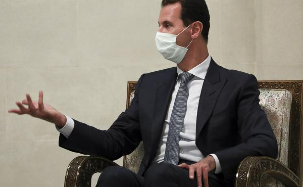 Syrian President Bashar Assad gestures while speaking to Russian Foreign Minister Sergey Lavrov during talks in Damascus in September. Assad and his wife, Asma, have been diagnosed with coronavirus infection, according to an official statement.