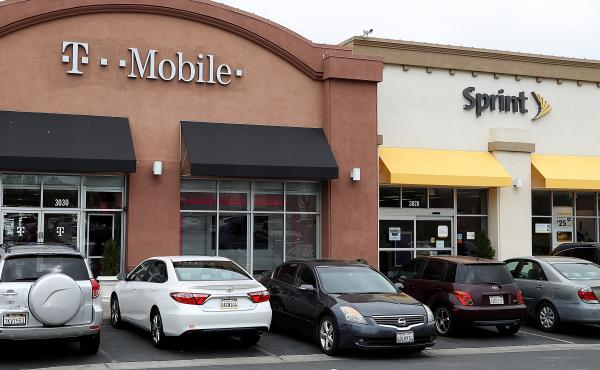 T-Mobile and Sprint stores in El Cerrito, Calif. The Department of Justice approved the $26 billion merger of the two wireless carriers.