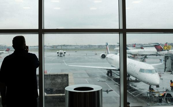 A passenger looks over planes sitting on the tarmac at LaGuardia Airport in New York City on Nov. 22. A previously undisclosed TSA program flags passengers for observation, and undercover air marshals observe their behavior — including whether they make