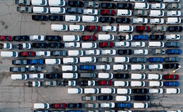 In this aerial photo, pickup trucks and vans are seen last month in a parking lot outside a General Motors assembly plant where they are produced in Wentzville, Mo. A key component in the car industry is in short supply: computer chips. Taiwan's chipmaker
