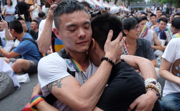 Same-sex marriage supporters hug outside Taiwan's legislature in Taipei on Wednesday after a landmark decision was announced that paves the way for the island to become the first place in Asia to legalize gay marriage.