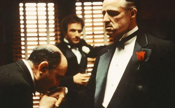 From left to right, Salvatore Corsitto as Bonasera, James Caan as Santino 'Sonny' Corleone and Marlon Brando as Don Vito Corleone in 'The Godfather'.