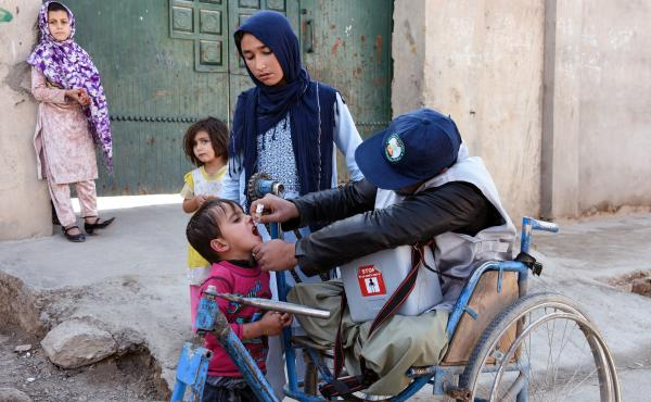 An Afghan health worker administers a polio vaccine to a child in Kandahar province in 2019. Since 2018, the Taliban has blocked polio vaccination campaigns in parts of the country it controls. Now they're reportedly changed their position.