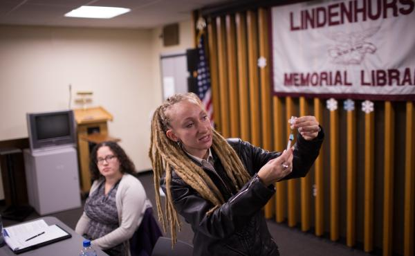 Tina Wolf demonstrates the use of naloxone to community members in Lindenhurst, N.Y., during an overdose prevention training. Georgia Dolan-Reilly (left) of the Suffolk County Prevention Resource Center helped with the training.