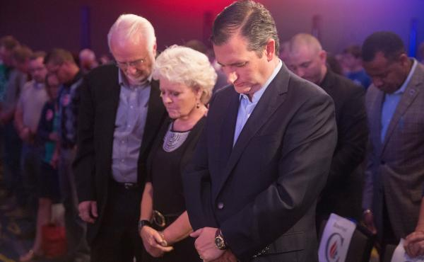 Sen. Ted Cruz prays before the start of his Religious Liberty Rally last weekend in Des Moines, Iowa. The event was part of Cruz's push to energize evangelical voters.