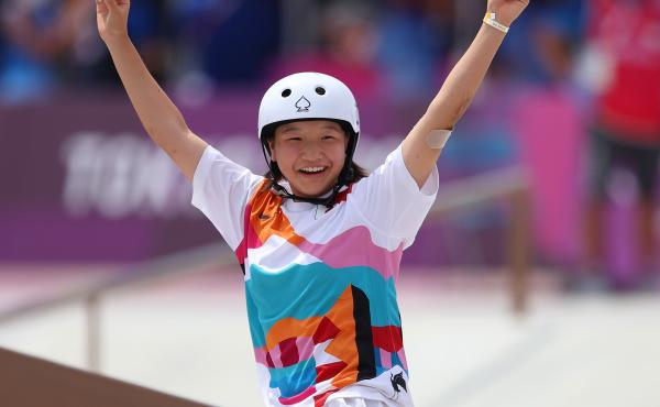 Momiji Nishiya of Team Japan celebrates during the Women's Street Final on day three of the Tokyo 2020 Olympic Games on Monday at Ariake Urban Sports Park.