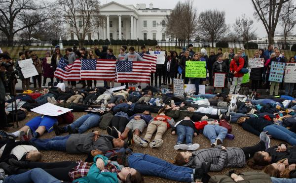"""Demonstrators participate in a """"lie-in"""" during a protest in favor of gun control reform in front of the White House. Grassroots groups are planning hundreds more protests in coming weeks."""