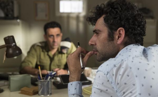 Palestinian screenwriter Salam (Kais Nashef, R) takes script advice from Israeli officer Assi (Yaniv Biton, L) in this satire by Sameh Zoabi.