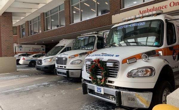 Ambulances fill the loading area at Vanderbilt University Medical Center in Nashville. The hospital has tried to adjust to the surge of new infections by dedicating three floors for treatment of COVID-19 patients, and creating two COVID-only intensive car