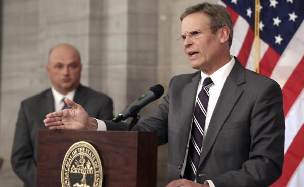 Tennessee Gov. Bill Lee, right, answers questions concerning the state's response to the coronavirus Monday, March 16, 2020, in Nashville, Tenn.