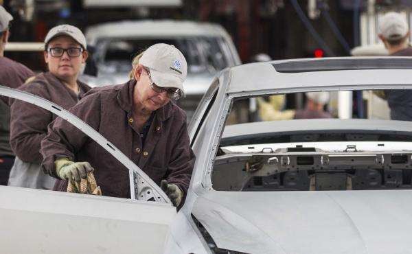 Workers produce vehicles at Volkswagen's U.S. plant in Chattanooga, Tenn. Some 1,600 workers have narrowly voted against unionizing the plant, the second time an effort to unionize the plant has failed in recent years.