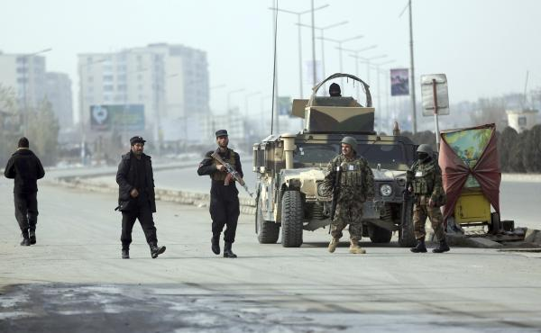 Security forces guard the site of a clash between gunmen and security forces in Kabul on Monday. Gunmen stormed a partially constructed building near an intelligence training center, triggering a gun battle with security forces as detonations and shooting
