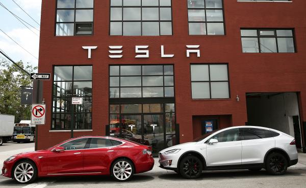 Tesla vehicles sit parked outside a new Tesla showroom and service center in Brooklyn, New York on July 5. The electric car company has come under increasing scrutiny following a crash of one of its electric cars while using the controversial Autopilot fe