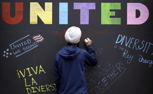 """In December, a Texas A&M student signs a message board ahead of an """"Aggies United"""" event in response to a speech by white separatist Richard Spencer. Spencer was scheduled to return to the school for a """"White Lives Matter"""" rally on Sept. 11."""