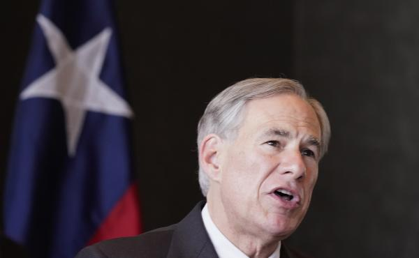 Texas Gov Greg Abbott pictured in March. He has threatened to block the pay of lawmakers who left the state House chamber rather than vote on a bill they say would make it harder to vote.