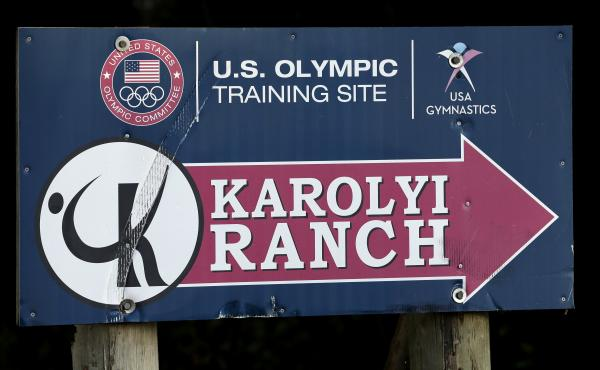 A sign points down the road to the Karolyi Ranch near Hunstville, Texas, in 2015. Gov. Greg Abbott said Tuesday he has ordered a criminal investigation into claims that former doctor Larry Nassar abused athletes at the facility, which served as the traini