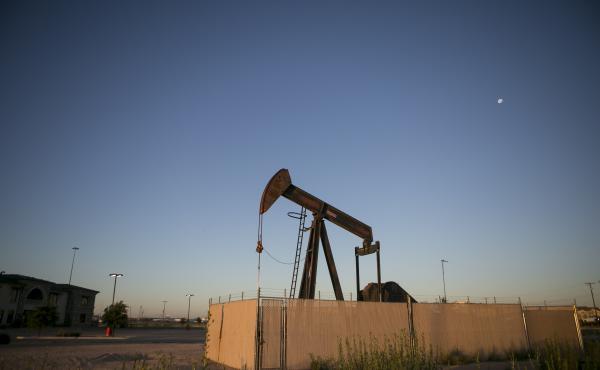 Pump jacks dot the landscape outside Midland, a West Texas oil town.