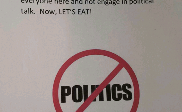 One of the many signs hung throughout the house where Kendall Patterson had her dinner with family. It was a reminder to check politics at the door — and, Patterson hopes, possibly a tradition for years to come.