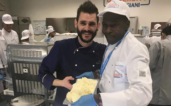 Damiao Justino Macamo, right, helped produce this batch of gelato during his first day at Carpigiani Gelato University in Bologna, Italy, with the help of instructor Luca Cappelletti.