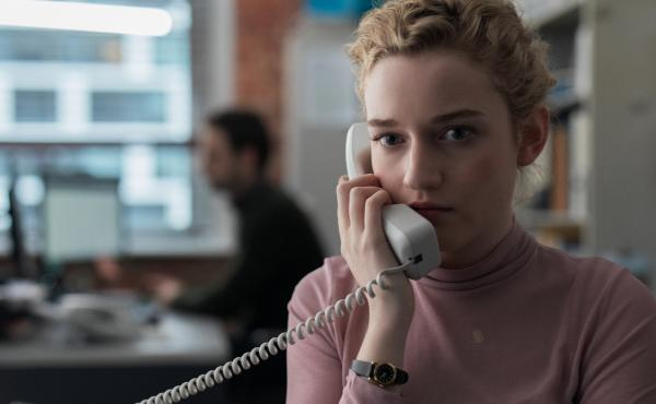 Julia Garner stars as a young college graduate who grows increasingly uncomfortable working for a New York-based movie mogul in The Assistant.