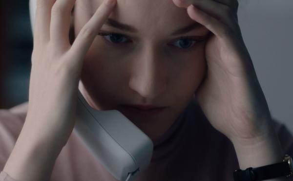 Jane (Julia Garner) slowly comes to realize something terrible about her boss in Kitty Green's The Assistant.