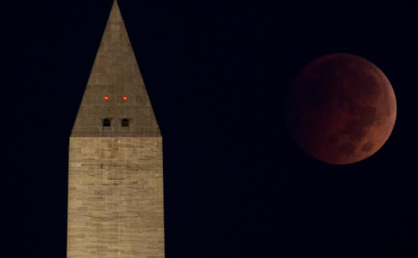 "The ""blood moon"" eclipse above the Washington Monument just before dawn on the National Mall, in Washington, D.C."