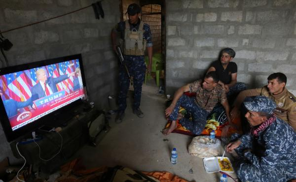 Members of the Iraqi forces watch Donald Trump giving a speech after his election win. They are part of the ongoing military operation to retake the Iraqi city of Mosul from ISIS, which Trump has vowed to destroy.