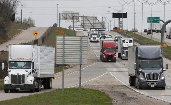 A truck leaves the highway at the Hefner Road exit of I-35 in Oklahoma City on March 20. Truckers say that the impact from the coronavirus is twofold: Some have more loads now because of shortages, while others say that their customers are not ordering an