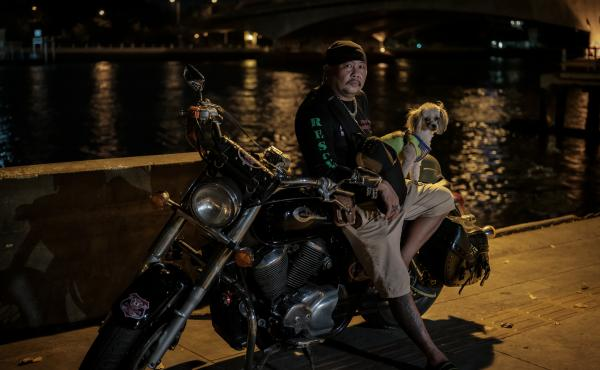 Suchart Prasomsu, 53, leads a rescue team of 30 volunteers in Bangkok, using his Harley to get to car crashes and crime scenes. Since the start of the pandemic, they've also been called on to try and keep people from killing themselves.