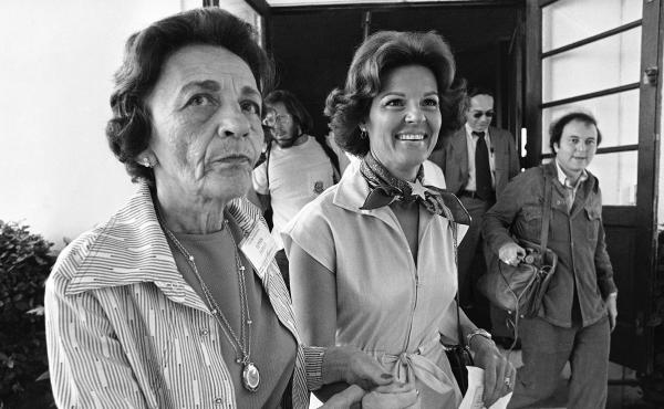 Singer Anita Bryant (right) is led to the voting booth at her Miami Beach polling place by volunteer Leah Dezen in 1977. Bryant was the leader of the opposition group Save Our Children, whose members pushed for the repeal of a gay-rights ordinance in Miam