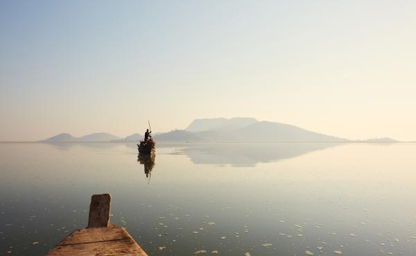 A fisherman's boat makes its way across Lake Chilwa in Malawi. A large portion of Lake Chilwa dries out every year, and the fishing industry disappears along with it. Most fishermen then head to Lake Malawi, where there is fishing year-round.