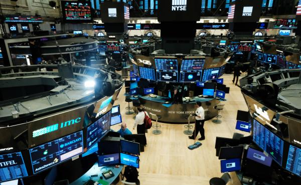 Trading ends for the day on the floor of the New York Stock Exchange on March 20. It was the last day before the exchange switched to all-electronic trading in an effort to help contain the spread of the coronavirus.