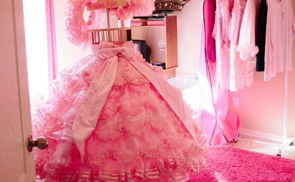 Some families dedicate an entire room to storing the dress, which is composed of many parts, including pantaloons, a parasol, a hoop skirt and a sash.