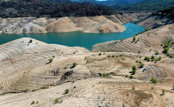 Warmer temperatures are leading to emptier reservoirs across the West, such as Lake Oroville in Northern California.