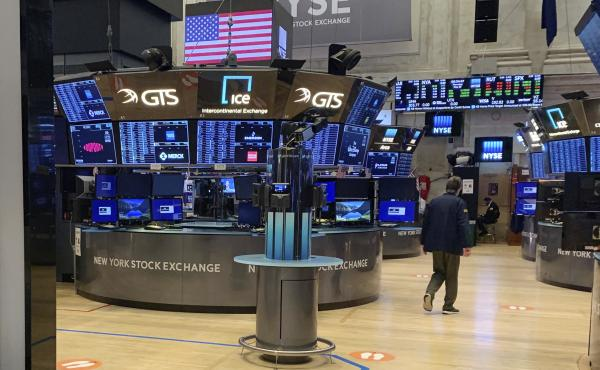 Even with millions of people out of work, the stock market has regained much of the ground it lost since March. Above, a trader walks across the trading floor of the New York Stock Exchange on May 28.