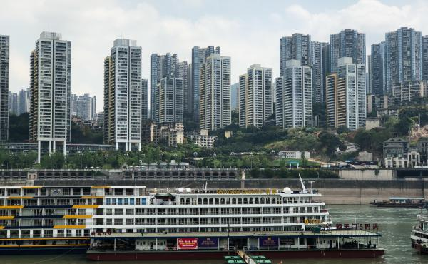 A passenger vessel traveling down the Yangtze River stops at a dock in downtown Chongqing, China.