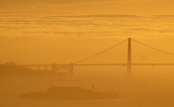 "A sea of fog advances on the Golden Gate Bridge during a late winter twilight in 2016. On Saturday, the operators of FogCam said the long-running webcam at San Francisco State University will sunset ""forever"" at the end of August."