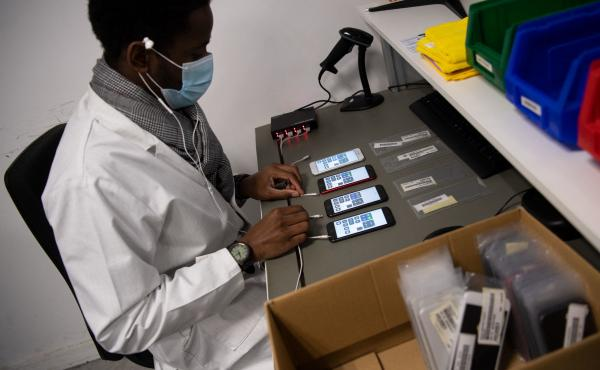 An employee works on smartphones reconditioning in France in January.