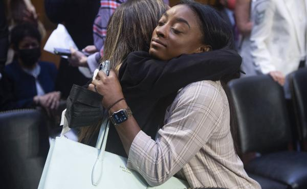 United States gymnasts Kaylee Lorincz and Simone Biles hug after a Senate Judiciary hearing about the Inspector General's report on the FBI's handling of the Larry Nassar investigation on Sept. 15, 2021.