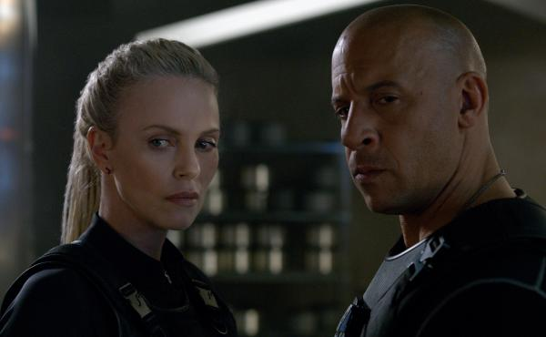 The aptly named villain Cipher (Charlize Theron) recruits Dominic Toretto (Vin Diesel) in The Fate of the Furious.