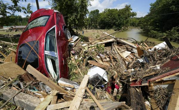 Debris could be seen piled up in Waverly, Tenn., on Sunday after heavy weekend rains caused deadly flash flooding. Climate change is driving more torrential rain around the world.