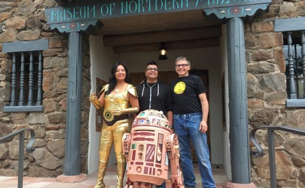 Geri Hongeva (left), who voiced C-3PO in the Navajo translation of A New Hope; artist Duane Koyawena (center); and engineer Joe Mastroianni with Hopi R2 at the Museum of Northern Arizona in Flagstaff.