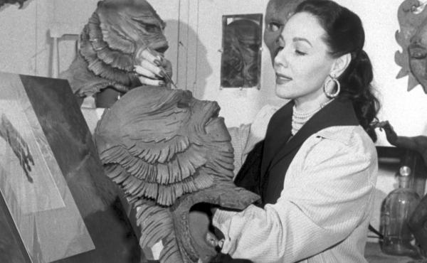 Milicent Patrick poses in the Universal Studios monster shop with her most famous creation: the Creature from the Black Lagoon.