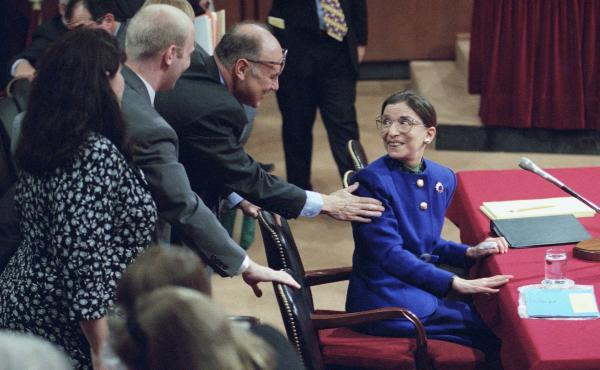 Then-Supreme Court nominee Ruth Bader Ginsburg greets her husband, Martin, during her confirmation hearing in 1993. She didn't hesitate to answer questions about Roe v. Wade and other topics she considered settle law.
