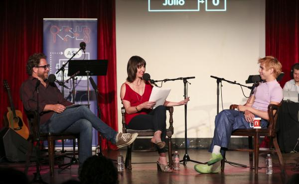 Jonathan Coulton and Ophira Eisenberg lead a game with Julio Torres on Ask Me Another at the Bell House in Brooklyn, New York.