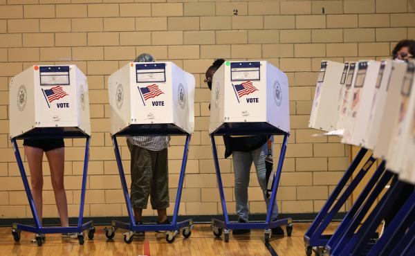People vote during the Primary Election Day at P.S. 249 The Caton School on June 22 in the Flatbush neighborhood of Brooklyn borough in New York City.