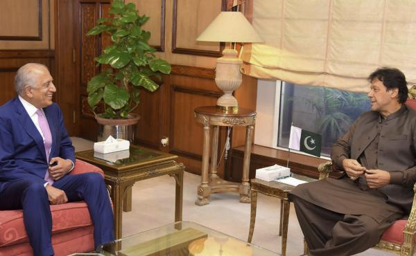 Pakistan's Prime Minister Imran Khan meets U.S. Special Envoy Zalmay Khalilzad (left) in Islamabad on Aug. 1. Khalilzad met Khan ahead of peace talks in Qatar with the Taliban.