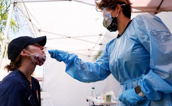 A medical assistant administers a coronavirus test last week in Los Angeles. COVID-19 cases are on the rise as the highly transmissible delta variant has become the dominant coronavirus strain in the United States.