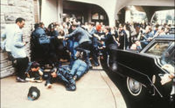 Police and Secret Service agents react to the assassination attempt on President Ronald Reagan in 1981 outside the Hilton Hotel in Washington, DC.